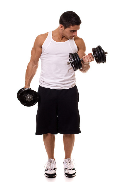 Alternating standing dumbbell biceps curls - supinated