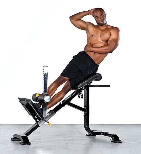 Roman chair exercises obliques side bends on a hyperextension bench