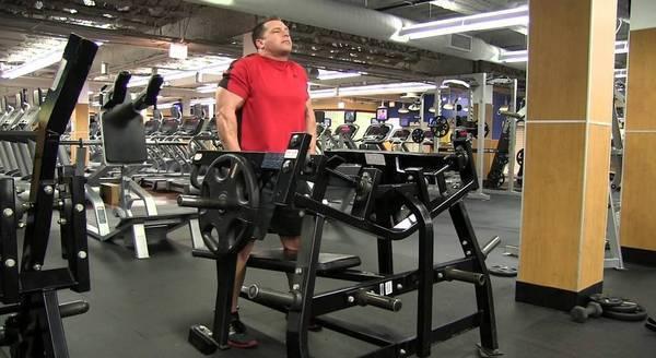 Shrugs on a horizontal bench press machine