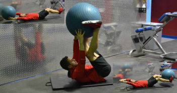 Stability Ball Hand To Feet Pass Exercise
