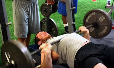 Bouncing the bar off your chest - bench press