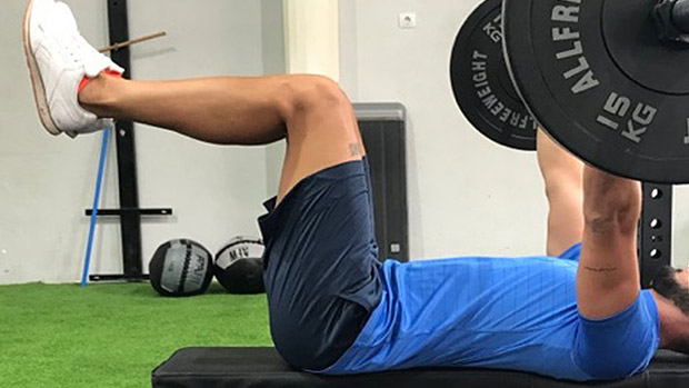 Benching with legs up in the air risk benefit ratio