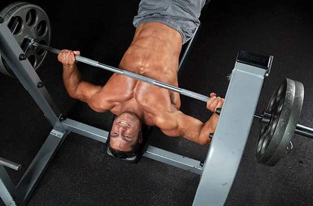 lowering bar to mid-chest area while benching